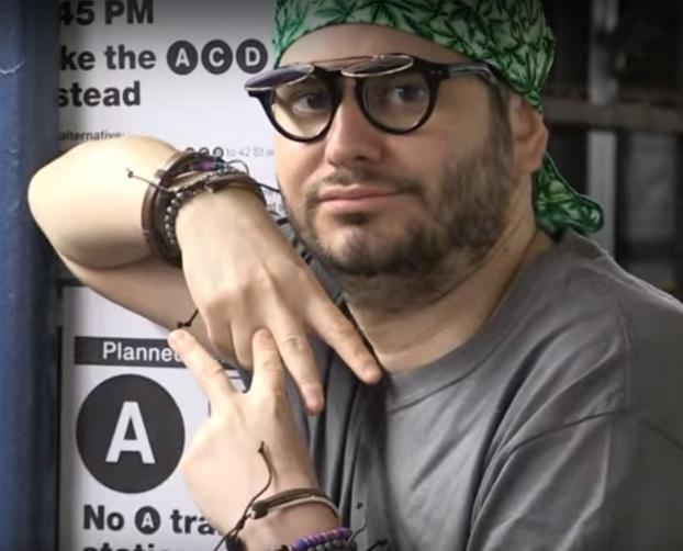 guy with bandana glasses vaper hand sign NYC Vape Nation